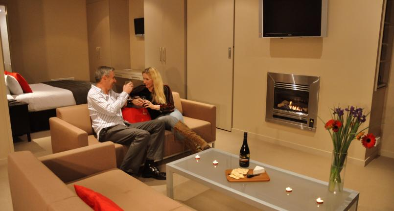 Dining Lounge Couple Fire King One Two Bedroom Highview Apartments - Queenstown Luxury Accommodation